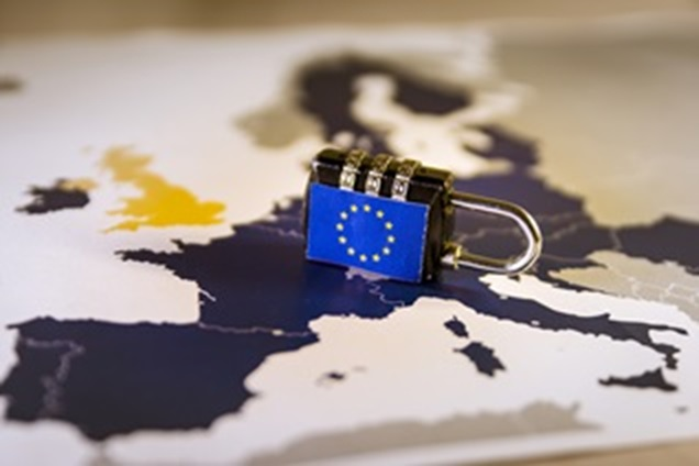 Combination padlock with EU flag on a map of Europe. The UK is highlighted in yellow.