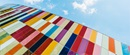 Multi colour panels cladding a building with camera facing skyward
