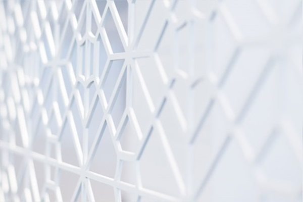 Screen with white tesselating patterns at Mishcon office