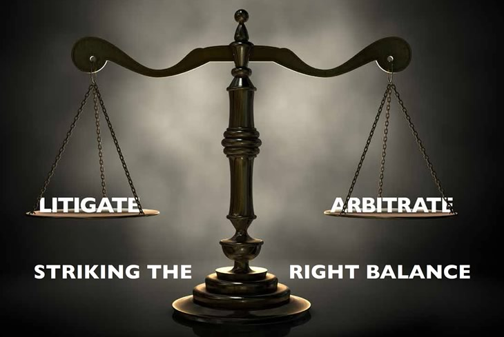 Scales of justice, balanced on the left by 'Litigate' and on the right by 'Arbitrate'